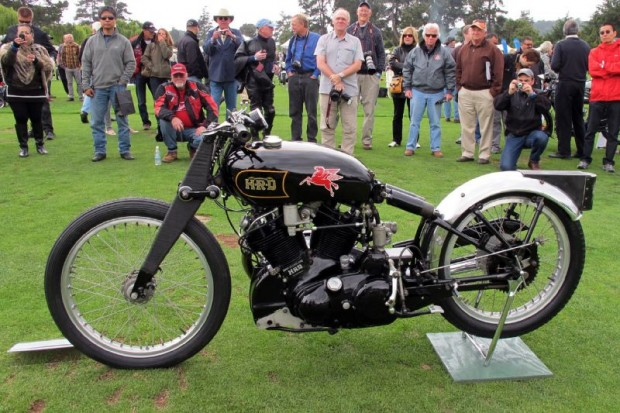 """The John Edgar Lightning 1948 Vincent 1000cc V-Twin on which Rollie Free set the American Class A record of 150.313 mph at Bonneville that year riding flat out and wearing only bathing suit and tennis shoes.  The one-off bike built by the factory for John Edgar burned alcohol fuel to make 108 horsepower.  Known as """"The World's Most Famous Motorcycle"""" it draws crowds at The Quail here while displayed by current owner William E. (Chip) Connor.  The author, William Edgar, is a former owner of this iconic Vincent HRD."""