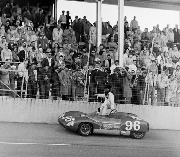 Dan Gurney's Lotus blew its engine so he parked the car on the 18 degree bank near the start finish.  This photo shows him getting back into the car after talking to the starter and finding out that the checkered flag will drop momentarily.