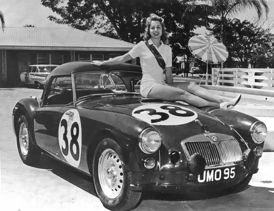 "Today they call them ""Promo Girls"" but young women and fast cars have been a part of racing since the first checkered flag was waved. This young lady was part of the promotional effort of the British Motor Corporation. BARC boys photos."