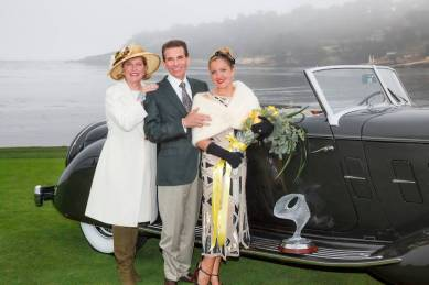 The Cassini family next to their 1934 Packard 1108 Twelve Dietrich Convertible Victoria that won Best of Show at the 2013 Pebble Beach Concours d'Elegance.