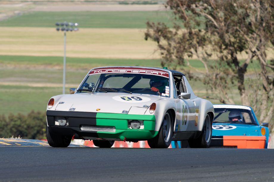 Hans Lapine's 1970 Porsche 914/6 followed by Mark Leonard's 1970 Porsche 914/6 into two.
