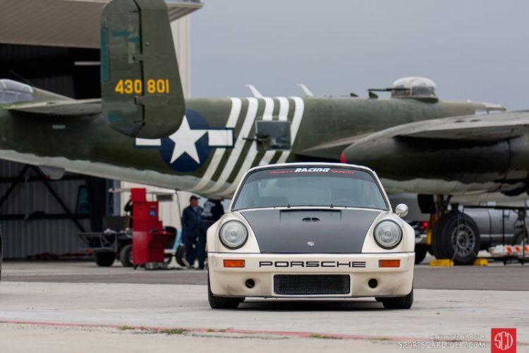 1976 Porsche 911 with a B-25 Mitchell bomber in the background