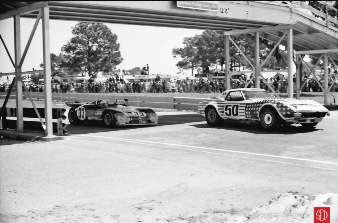 A Greenwood Vette about to be passed by the Galli/Stommelen Alfa T33/3 (Photo: Louis Galanos)