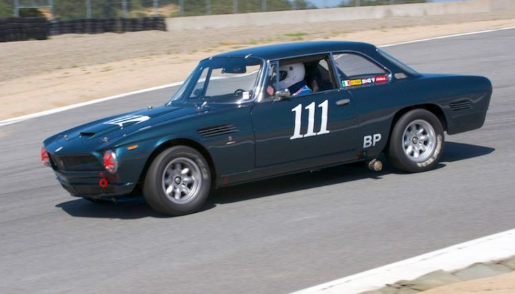 Just going into the Corkscrew is the 1964 Iso Rivolta GT of Pete Whitehead.
