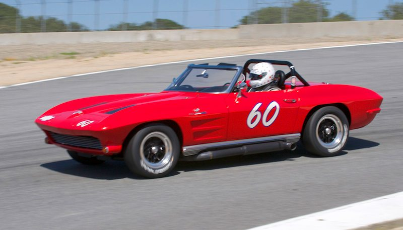 1963 Corvette of Terry Miller enters the Corkscrew.