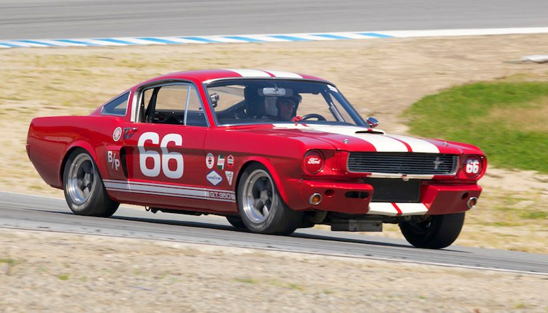 Mark Cane's 1966 Shelby GT350 exits turn five.