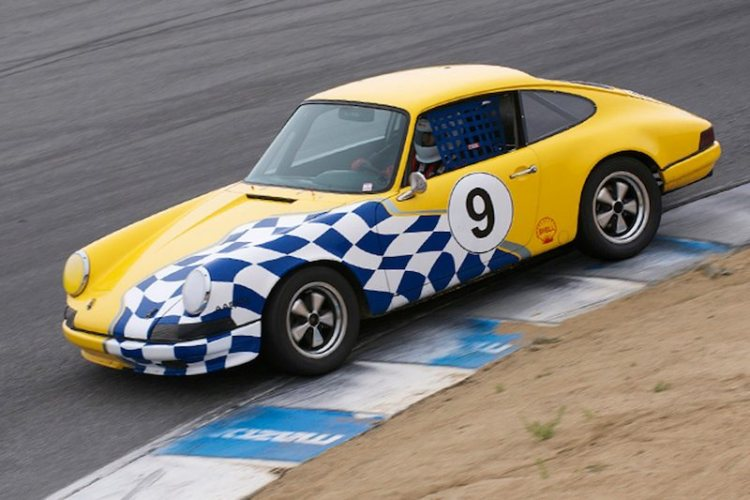 Beautiful in yellow with blue and white graphics, the 1967 Porsche 911 of Gilbert Hakim.