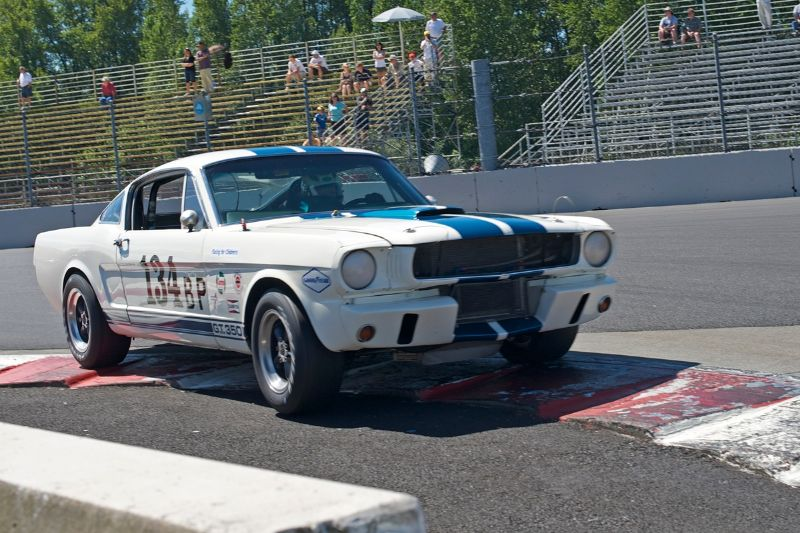John McKenna three wheels his 1965 Ford Mustang in turn 1.