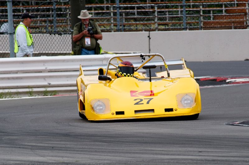 Lola T290 of Keith Frieser. Note photogrpahers hard at work in the background.