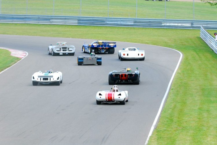 Group 2 turns unto the front straight and the green flag.