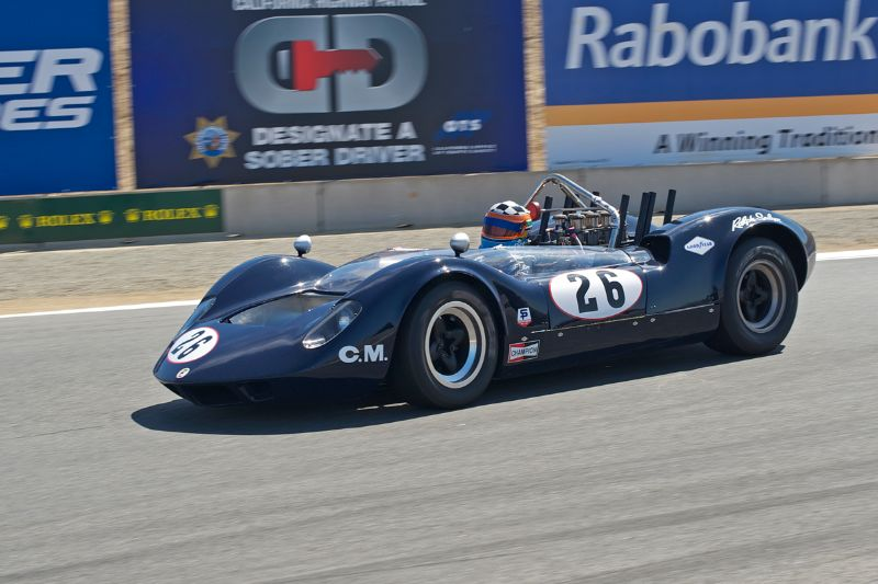 1965 McLaren M1A driven by Edith Arrowsmith in turn eleven.