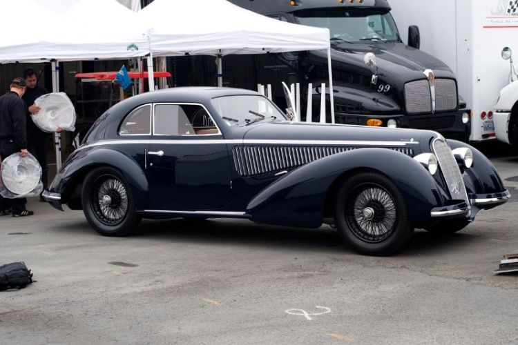 Jon Shirley's 1938 Alfa Romeo 8C 2900B. The crew is prepping the wheel covers before fitting to the car.