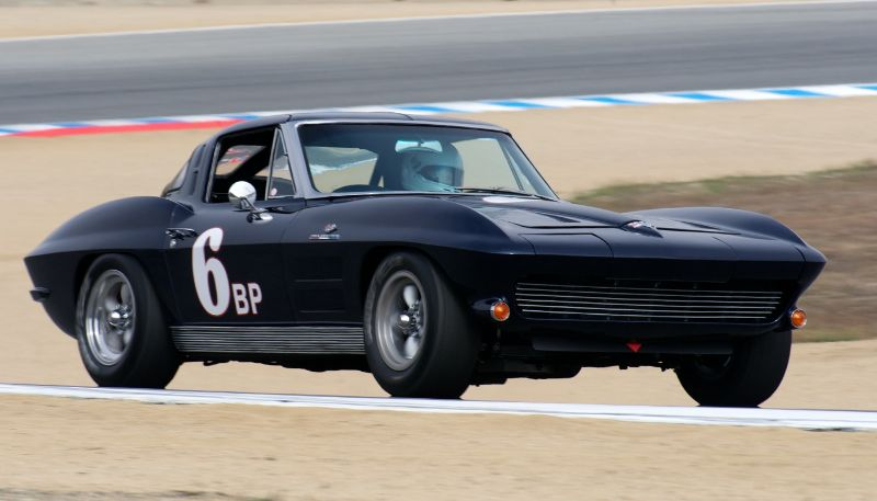 Susan Armstrong in her 1963 Corvette ZO6 exiting five.
