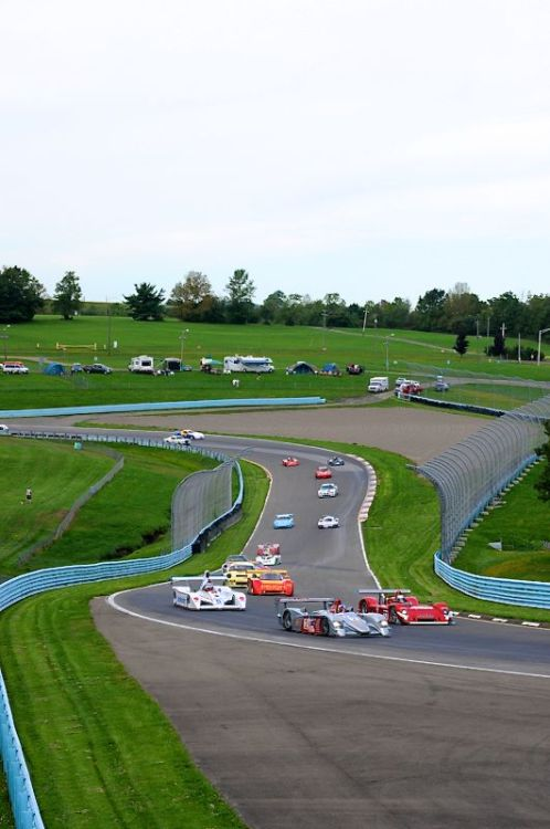 Group 7 heads into Turn 9 on their formation lap.