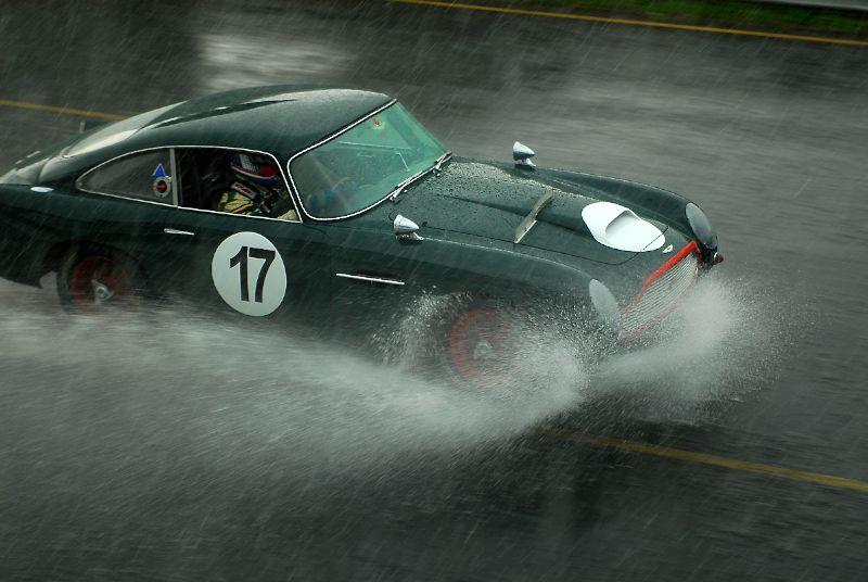 1959 Aston Martin DB4GT of James Freeman splashes down pit road.