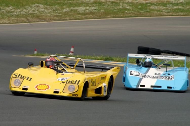 Mike Thurlow's 1973 Lola T294 leads the 1972 Lola T292 of Rob Gritten up the hill towards two.