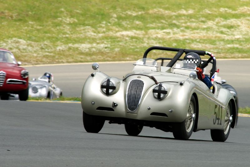 Friday afternoon practice. Mike Heffernan's 1954 Jaguar XK 120SE up the hill into two.