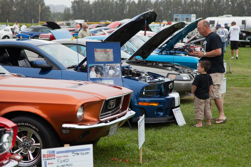 Both young and old admiring the 2006 Roush Stage 2 Mustang.