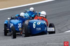 Readers chose Dennis Gray's picture of three timeless Bugattis in the Corkscrew at Laguna Seca as our best vintage car racing photo of 2010