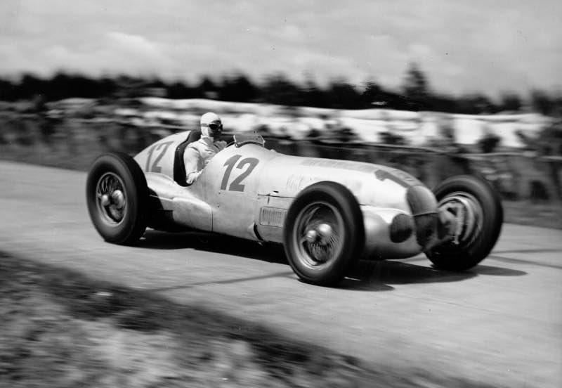 1937 German Grand Prix, the eventual winner Rudolf Caracciola in the Mercedes-Benz W 125