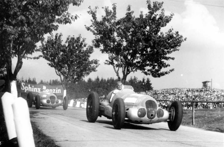Manfred von Brauchitsch ahead of Richard Seaman at the Masaryk Grand Prix in Brno. They finished in 2nd and 4th respectively, with Rudolf Caracciola winning the race. All driving the Mercedes-Benz W 125 750 kilogram racing car