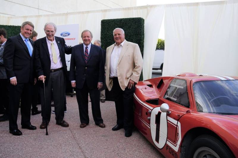 Henry Ford III, Dan Gurney, Edsel B. Ford II, A.J. Foyt, the 1967-Le Mans-winning Ford GT Mark IV. Photo credit: Albert Wong