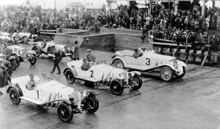 Just before the start of the inaugural race at the Nürburgring, 19 June 1927. Left to right: The subsequent winner Rudolf Caracciola (starting number 1), Adolf Rosenberger (starting number 2) - both in a Mercedes-Benz Model S - and, on the far right, private motorist Rittmeister von Mosch (starting number 3) in a Mercedes-Benz Model K.