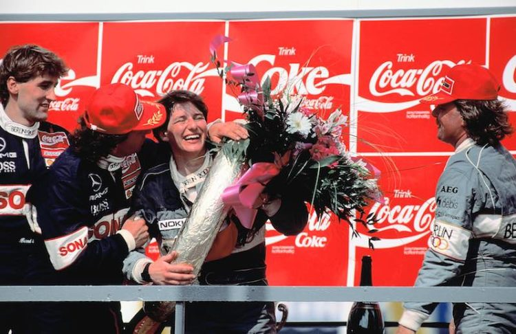 Ellen Lohr, winner of the first race at the 1992 Motor Sport Festival Hockenheim, is here seen being embraced on 24 May 1992 by laterDTM champion Klaus Ludwig. Lohr won the race as the first and still only woman in DTM history; she also posted the fastest lap of 1:05:35 min in an AMG-Mercedes 190 E 2.5-16 Evolution II racing tourer.