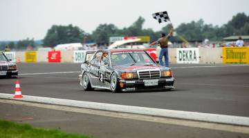 German Touring Car Championship, Diepholz Airfield Race, 16 August 1992. Klaus Ludwig (start number 3) won both races at the wheel of an AMG-Mercedes 190 E 2.5-16 Evolution II racing tourer and is here seen crossing the finishing line in first place.