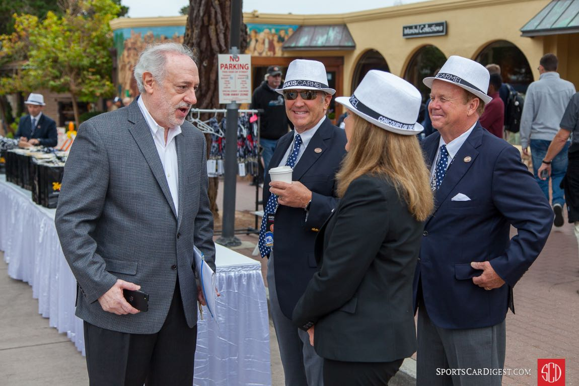 Event organizer, Douglas Freedman talks with a few of the event judges.
