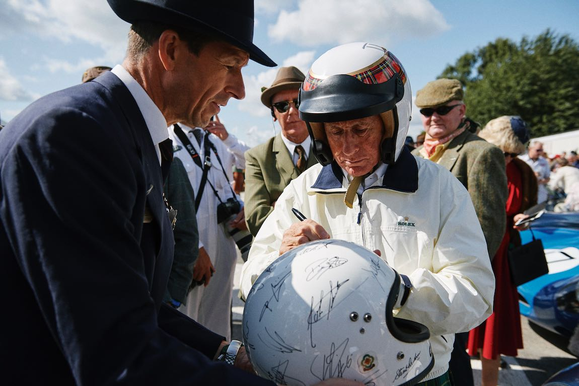 Sir Jackie Stewart signing autographs before the Ecurie Ecosse tribute