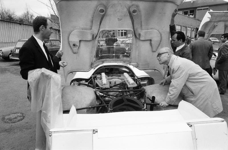 """1969: Ferdinand Piëch (left) next to the Porsche Type 917 LH Coupe at Porsche plant """"Werk 1""""."""