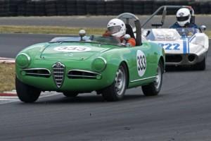 Tom Sahine's Alfa Romeo Giulietta Spider Veloce leads Bill Babcock's Peyote Mk11.