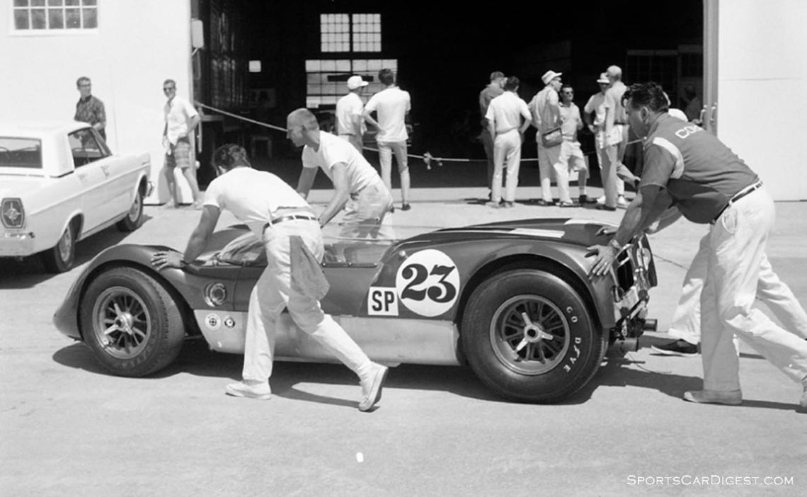 The Gurney/Grant Lotus 19J being pushed back to the airport garage in the days preceding the race. The theory about being the 'rabbit' never panned out because the car lost its chain drive on the oil pump around lap 43 and had to retire. (photo: Dave Nicholas)