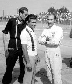 Ricardo Rodriguez and Stirling Moss prior to the start of the race. Ricardo and brother Pedro would team up driving a NART Ferrari Dino 196S. BARC boys photo.