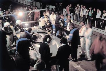 24 Hours of Le Mans, 10-11 June 1989. Night pit stop of Sauber-Mercedes C 9, Group C racing car, with starting number 63. Driver Jochen Mass, who was later to be the winner, stands at the ready to take over the steering wheel.
