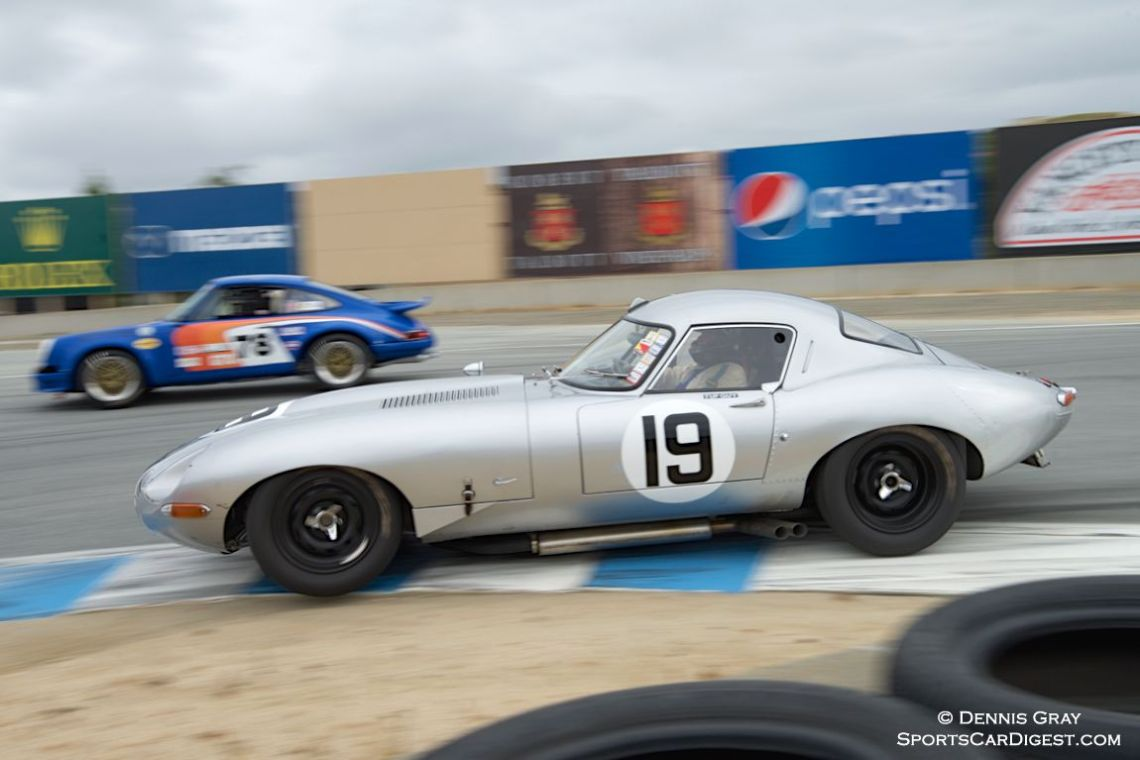 Nick Colonna grabs the inside line in his Jaguar E Type.