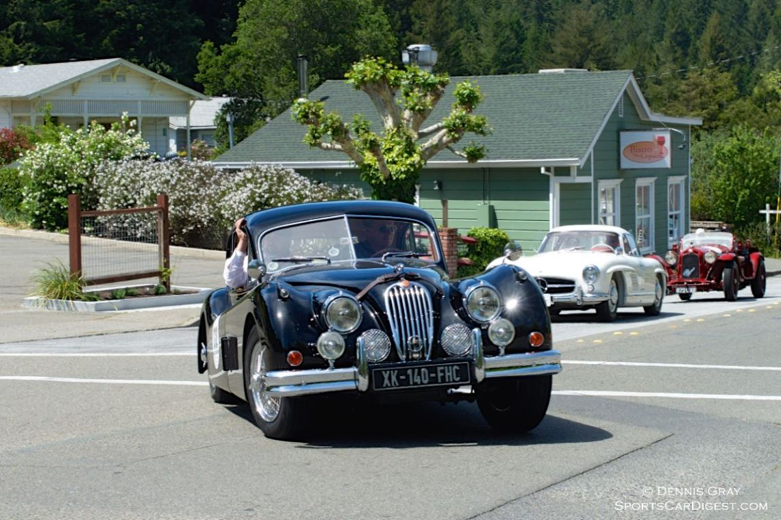 1956 Jaguar XK140 FHC driven by Michael Stern and William Widmaier.