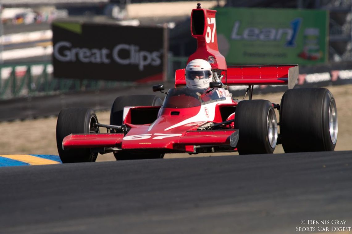 John Obialero's 1973 Lola T332 over the hill into turn three.