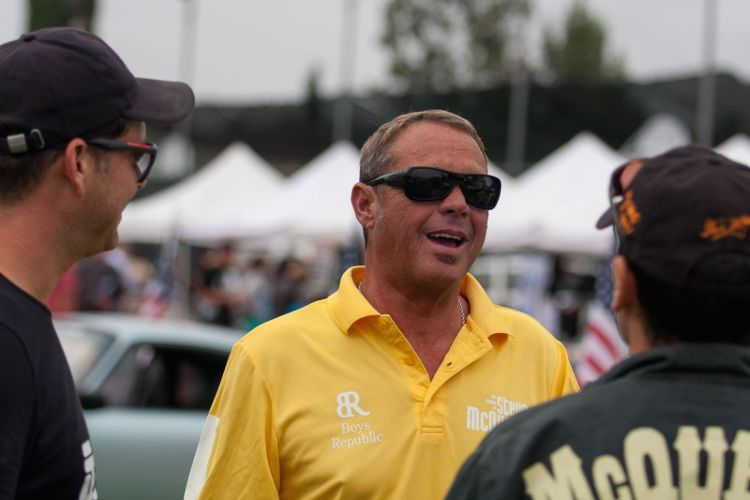 Chad McQueen enjoying the cars and talking with fellow enthusiasts.