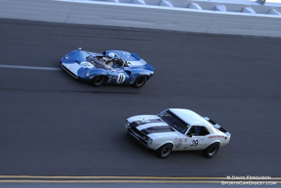 Lola T70 MkI Spyder and Chevrolet Camaro fighting for the lead.