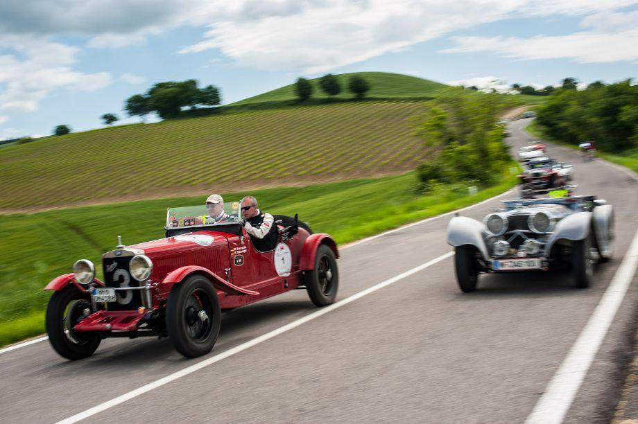1937 Jaguar SS-100 passing 1930 OM 665 SS