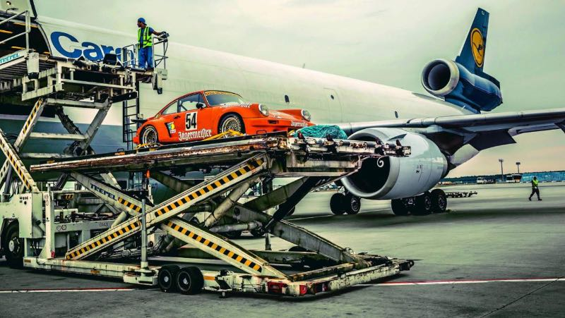Porsche 911 RSR 3.0 heads into the belly of a Lufthansa cargo plane