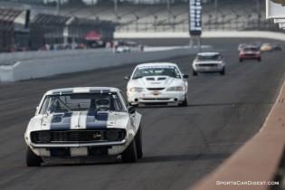 Camaro, Mustang, Camaro and Mustang head for turn one