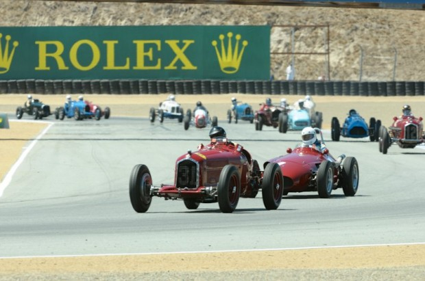 The 1930 Alfa Romeo Tipo B P3 of Peter Giddings is closely followed by Jeffery O'Neill in his 1957 Maserati 250F