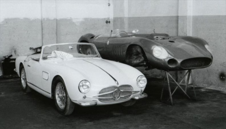 1957 Maserati 150 GT Spider prototype is pictured next to the body of a 300 S in the Maserati racing workshop. (photo: Walter Baumer)