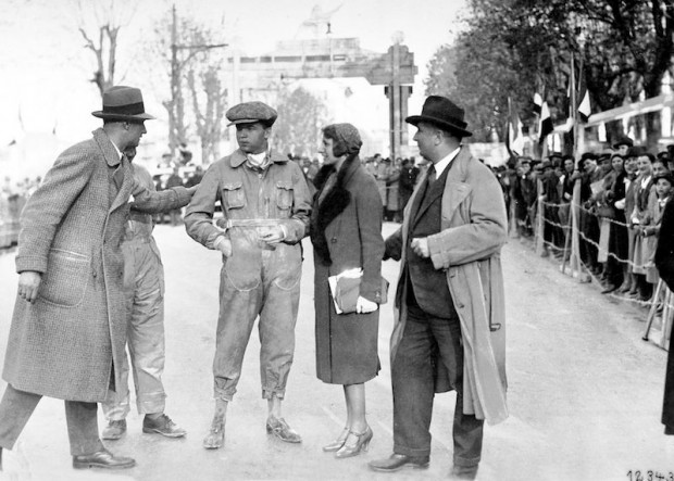 Charly Caracciola greets her husband Rudolf after his impressive victory in the 1931 Mille Miglia. Racing team manager Alfred Neubauer can be seen on the right of the picture.