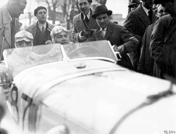 Winner Rudolf Caracciola and his co-driver Wilhelm Sebastian in a Mercedes-Benz SSKL racing car at the 1931 Mille Miglia finish line.