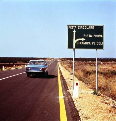The way to the high-speed track and the dynamics test area for cars at the Nardo Technical Center in 1975
