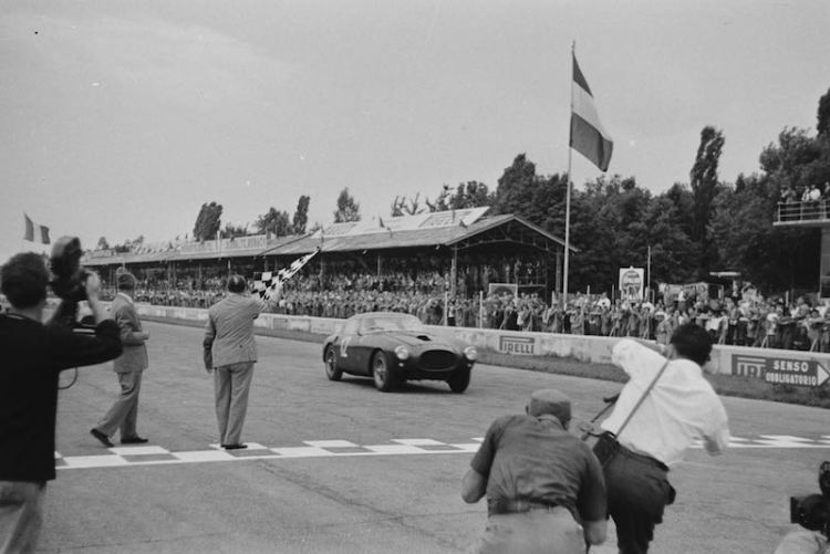 Crossing the finish line at the 1953 Monza Grand Prix, the winning Ferrari 250 MM Pinin Farina Berlinetta driven by Luigi Villoresi, is portrayed perfectly by Mailander with the checkered flag waving victoriously off to the side